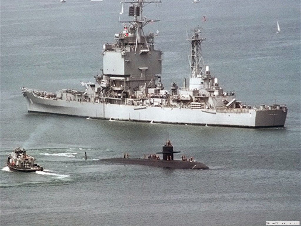 USS La Jolla (SSN-701) passes the USS Long Beach (CGN-9) 1982.