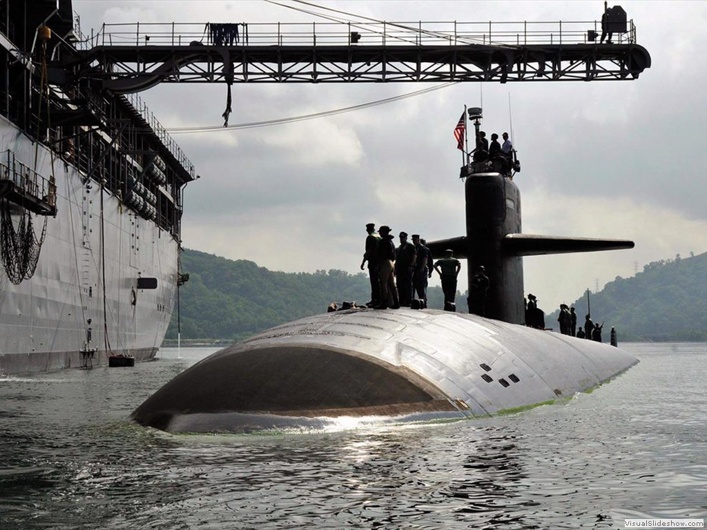 USS Louisville (SSN-724) pulls alongside USS E. S. Land (AS-39) in Malaysia 2012.