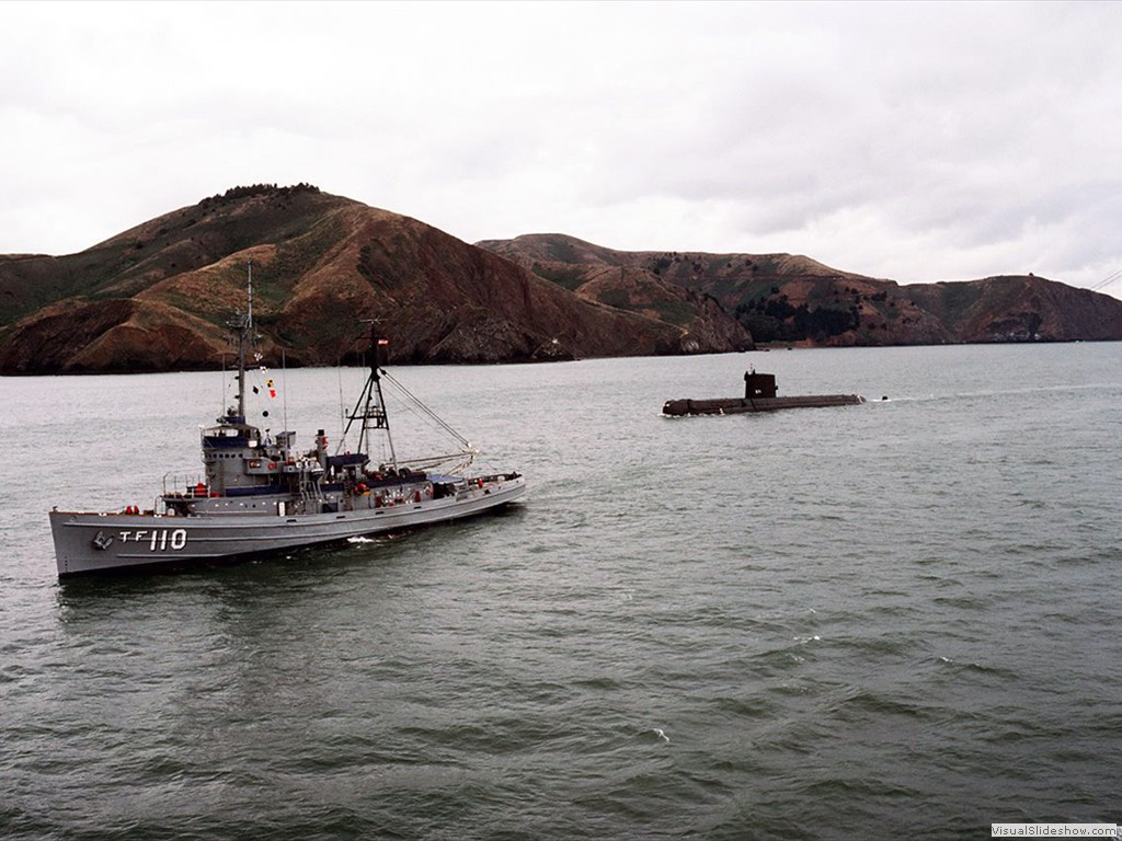 USS Nautilus (SSN-571) under tow near the Golden Gate Bridge during 1985.